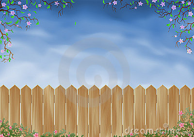 Wooden fence surrounded by flowers