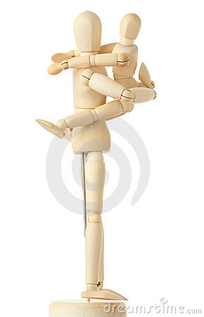 Wooden figures of child embracing his parent