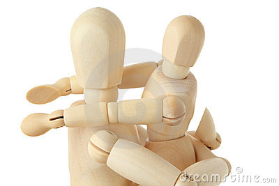 Wooden figures of child embracing parent