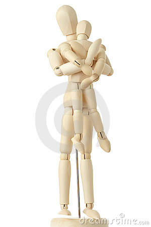 Wooden figures of parent carring child from back