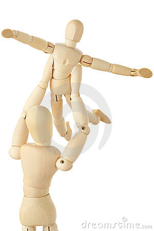 Wooden figures of parent carring child over head