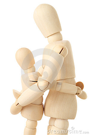 Wooden figures of parent embracing child