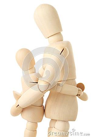Wooden figures of parent embracing child