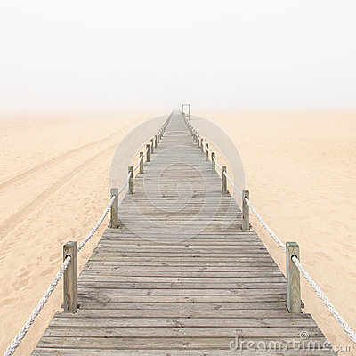 Free Wooden Footbridge On A Foggy Beach Background. Royalty Free Stock Images - 28090609