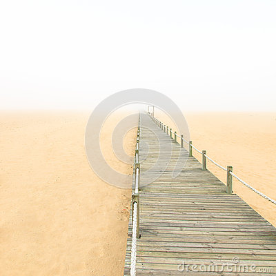 Free Wooden Footbridge On A Foggy Sand Beach Background. Portugal. Royalty Free Stock Photo - 29628415