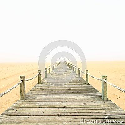 Free Wooden Footbridge On A Foggy Sand Beach Background. Portugal. Stock Photo - 46111200