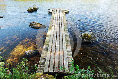 Wooden footway on the lake
