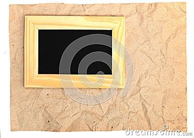 Wooden frame on old paper