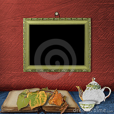 The wooden frame on the wall and  teapot