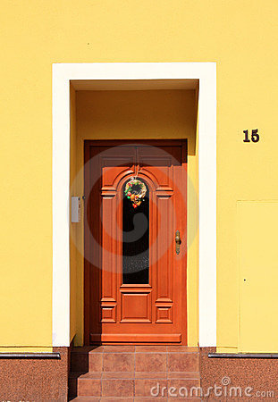 Wooden front door with easter decoration