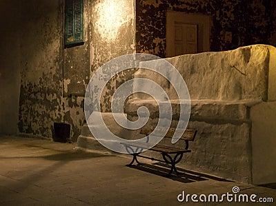 Wooden garden seat by night. Monopoli. Apulia.