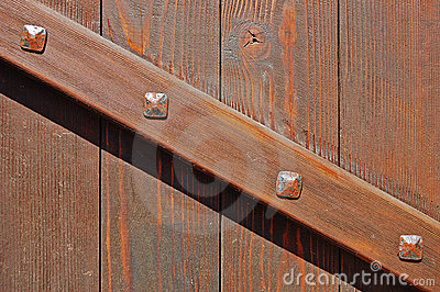 Wooden gate with brace fastened with forged bolts