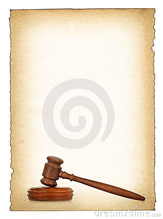 Wooden gavel against old dirty paper background