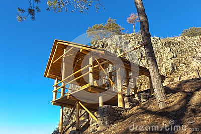 Wooden gazebo in the mountains