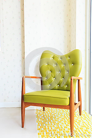 Wooden green arm chairs in living room