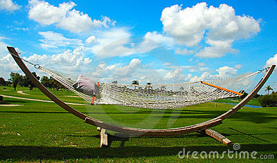 Wooden Hammock in a sunny day and bright blue sky