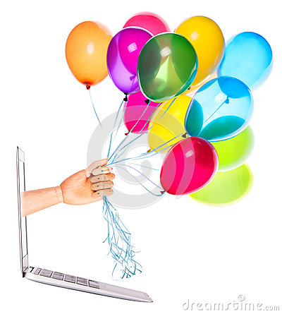 Wooden hand with balloons and laptop