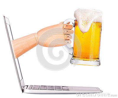 Wooden hand with beer and  laptop