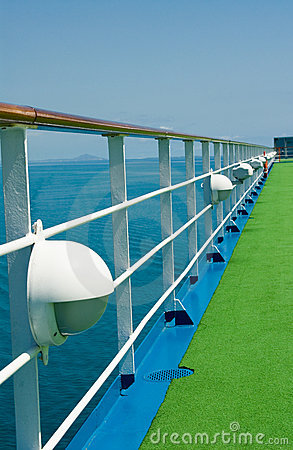 Wooden handrail on cruise ship deck at sea