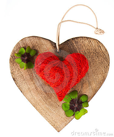Wooden heart and red heart