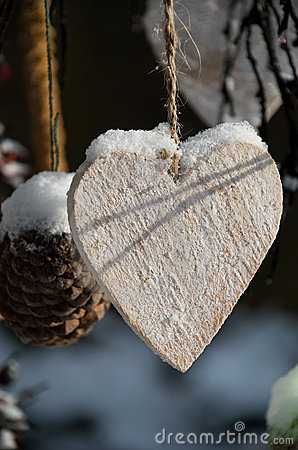 Wooden heart in snow
