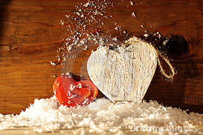 Wooden hearts in snow