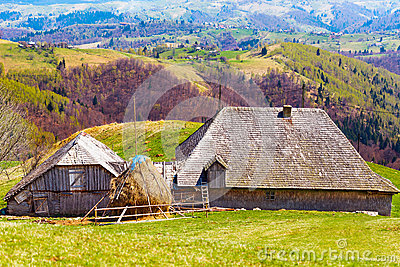 Wooden house and mountains