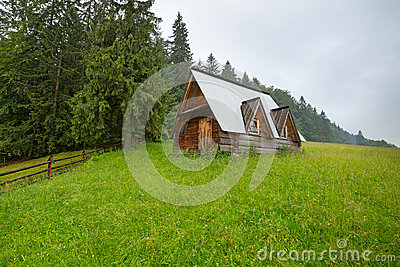 Wooden hut under Tatra mountains in Zakopane