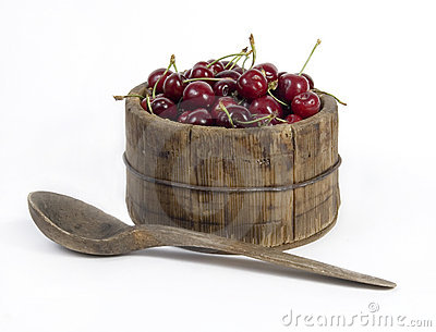 Wooden jar full of red cherries