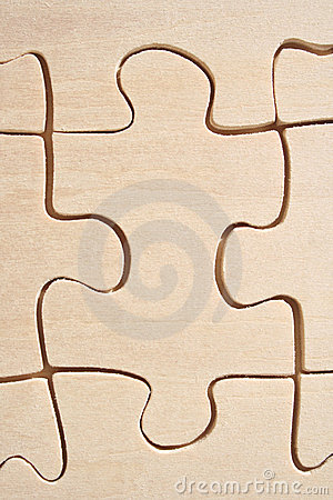 Wooden jigsaw close-up