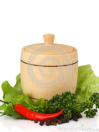 Wooden keg on fresh herbs with spices