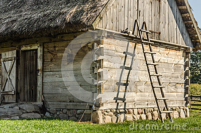 Wooden ladder leaning on a hut in the country