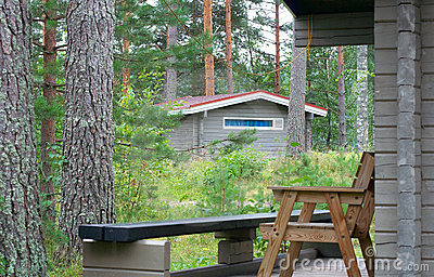 Wooden lodges in forest