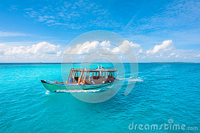 Wooden Maldivian traditional dhoni boat on a sunny