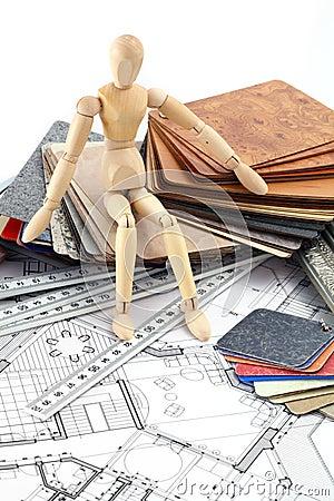 Wooden man, furnishing materials, blueprints