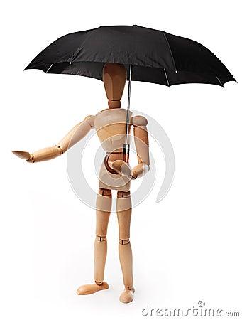 Wooden man holding an umbrella