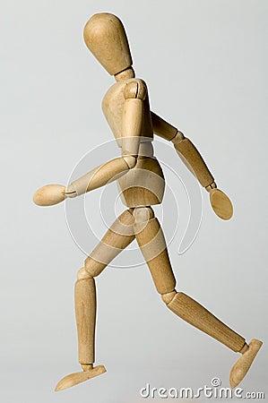 Wooden man walking