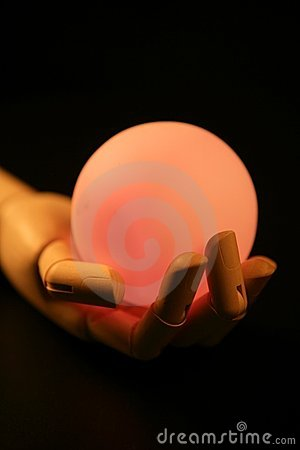Wooden mannequin hand, light ball, fortune