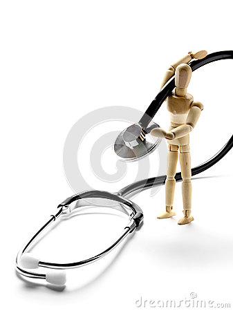 Wooden mannequin holding a stethoscope