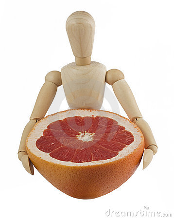 Free Wooden Mannequin With A Grapefruit Royalty Free Stock Images - 16322149