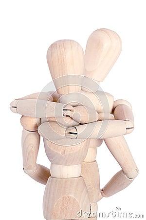 Wooden mannequins hugging