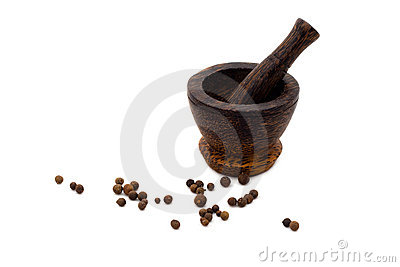 Wooden mortar culinary with black pepper