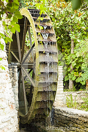 Wooden old mill wheel.