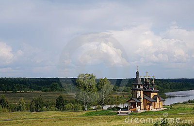 Wooden orthodox church on a river bank
