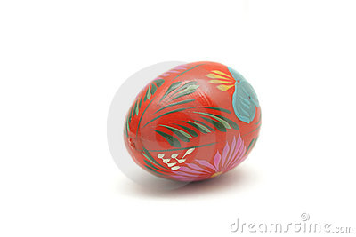 Wooden painted Easter egg isolated on white