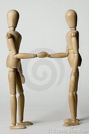 Wooden people shaking hands