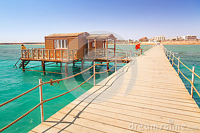 Wooden pier with change room house on Red Sea