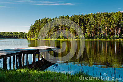 Wooden pier and forest on lake
