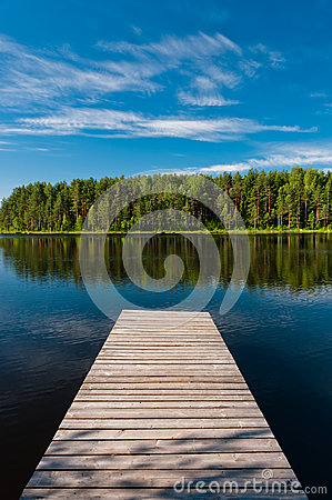 Wooden pier on lake symmetrical scene