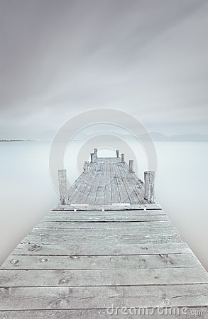 Free Wooden Pier On Lake In A Cloudy And Foggy Mood. Stock Photo - 28017360